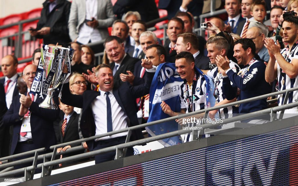 Neil Harris manager of Millwall celebrates victory and promotion with the trophy after during the Sky Bet League One Playoff Final between Bradford City and Millwall at Wembley Stadium on May 20, 2017 in London, England.