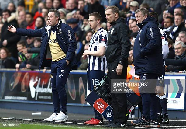 Neil Harris manager of Millwall gives his team instructions while Shane Ferguson of Millwall waits to come on during The Emirates FA Cup Fourth Round...