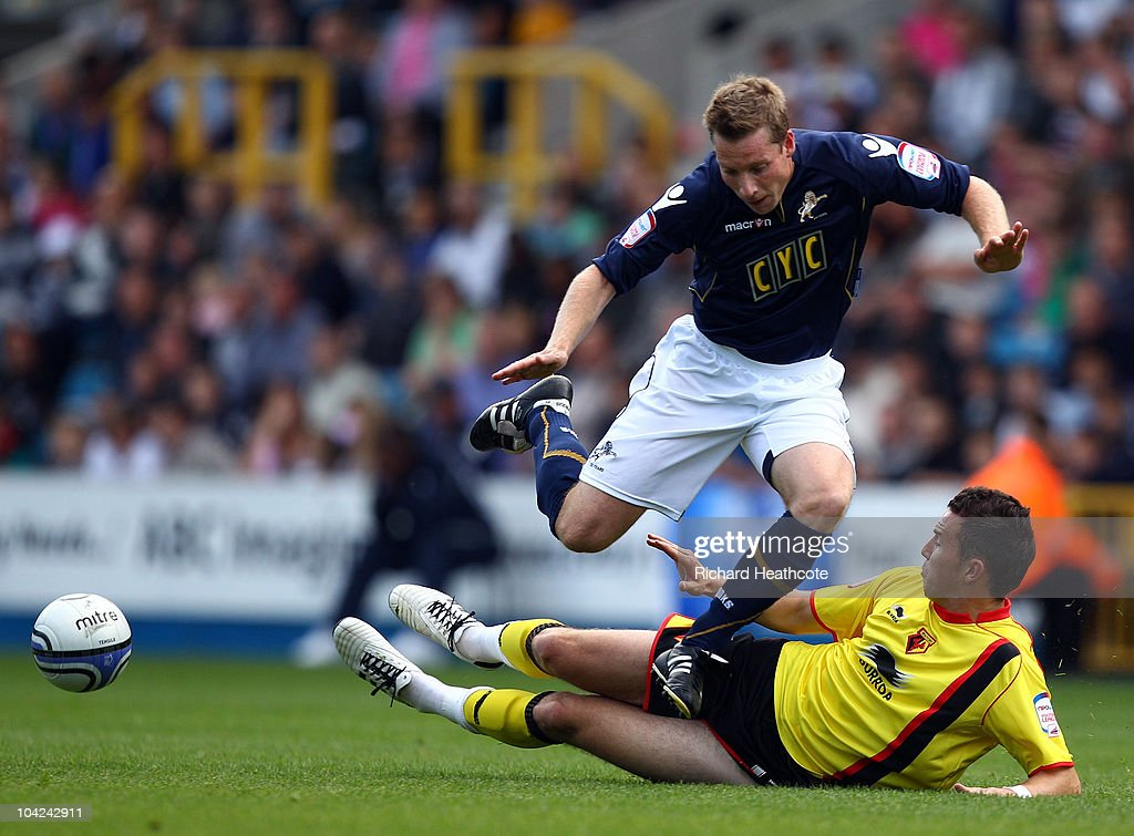 Neil Harris of Millwall is tackled by Jordon Mutch of Watford during the npower Championship match between Millwall and Watford at The Den on September 18, 2010 in London, England.