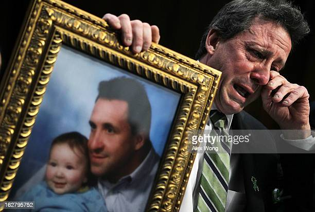 Neil Heslin father of sixyearold Sandy Hook Elementary School shooting victim Jesse Lewis wipes tears as he testifies during a hearing before the...