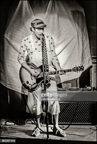 Neil Innes performing on stage Victoria Palace London 1975
