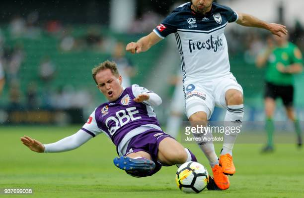 Neil Kilkenny makes a sliding tackle during the round 24 A-League match between the Perth Glory and the Melbourne Victory at nib Stadium on March 25,...
