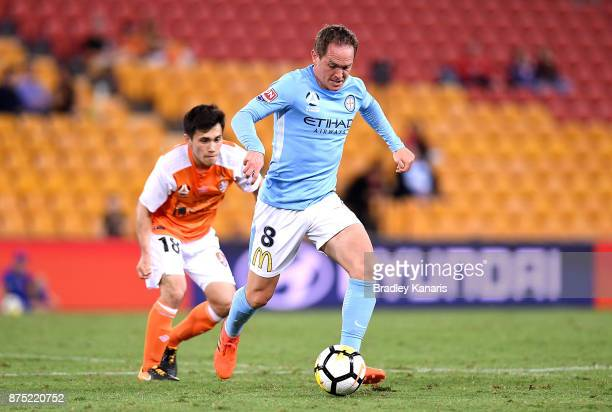 Neil Kilkenny of Melbourne City breaks away from the defence during the round seven ALeague match between Brisbane Roar and Melbourne City at Suncorp...