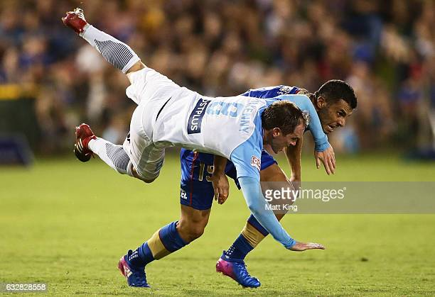 Neil Kilkenny of Melbourne City clashes with Andrew Nabbout of the Jets during the round 17 ALeague match between the Newcastle Jets and Melbourne...