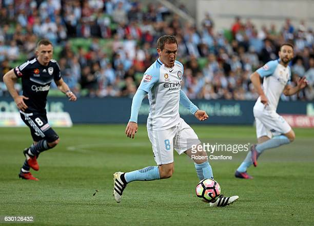 Neil Kilkenny of Melbourne City runs with the ball during the round 11 ALeague match between Melbourne City FC and Melbourne Victory at AAMI Park on...