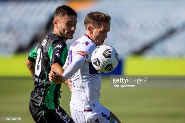Neil Kilkenny of Perth Glory and Ivan Vujica of Western United FC contest the ball during match week 5 of the 2021 A-League season between Western...