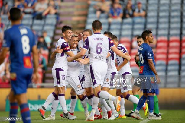 Neil Kilkenny of Perth Glory celebrates his goal with team mates during the round eight ALeague match between the Newcastle Jets and the Perth Glory...