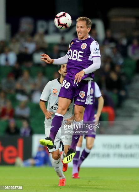 Neil Kilkenny of Perth Glory heads the ball forward during the round three ALeague match between the Perth Glory and the Brisbane Roar at nib Stadium...