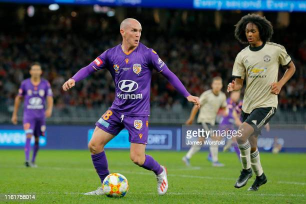 Neil Kilkenny of Perth Glory keeps control of the ball during the match between the Perth Glory and Manchester United at Optus Stadium on July 13...
