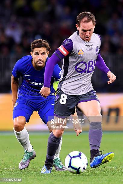 Neil Kilkenny of Perth Glory passes the ball during the international friendly between Chelsea FC and Perth Glory at Optus Stadium on July 23 2018 in...