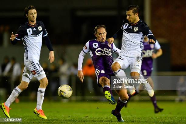 Neil Kilkenny of the Glory and Kosta Barbarouses of the Victory compete for the ball during the FFA Cup round of 32 match between Perth Glory and...