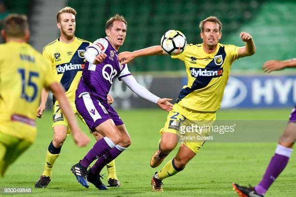Neil Kilkenny of the Glory and Wout Brama of the Mariners compete for the ball during the round 22 ALeague match between the Perth Glory and the...