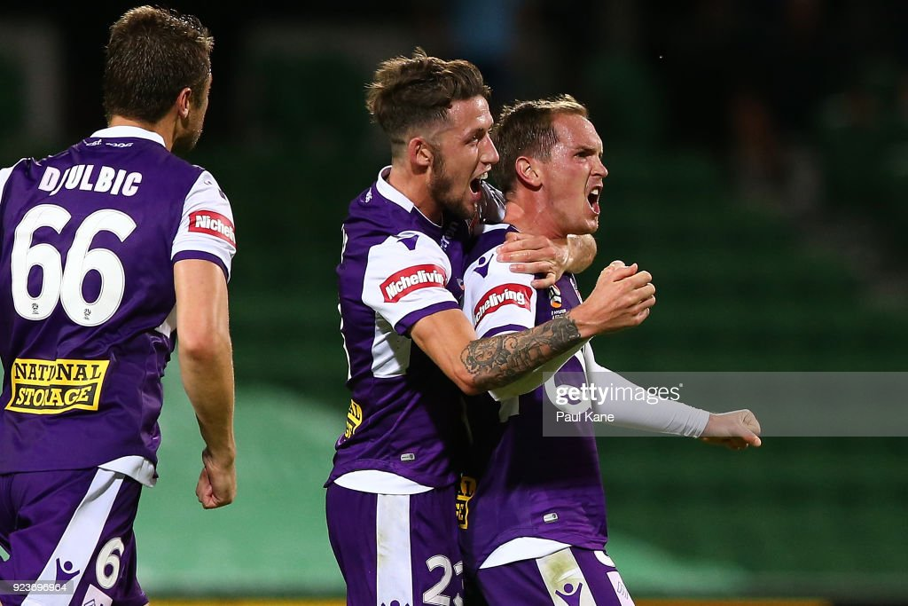 Neil Kilkenny of the Glory celebrates with Scott Neville after scoring a goal during the round 21 A-League match between the Perth Glory and Melbourne City FC at nib Stadium on February 24, 2018 in Perth, Australia.