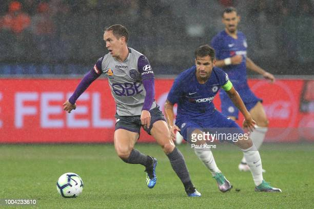 Neil Kilkenny of the Glory controls the ball against Cesc Fabregas of Chelsea during the international friendly between Chelsea FC and Perth Glory at...