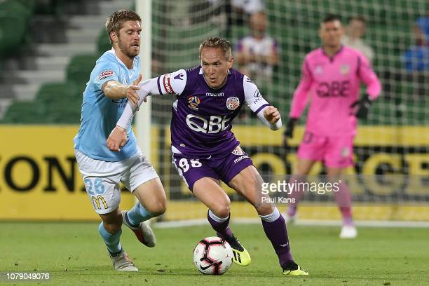 Neil Kilkenny of the Glory controls the ball against Luke Brattan of Melbourne during the round seven ALeague match between the Perth Glory and...
