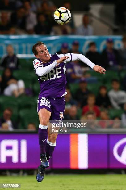 Neil Kilkenny of the Glory heads the ball during the round 25 ALeague match between the Perth Glory and Sydney FC at nib Stadium on March 29 2018 in...