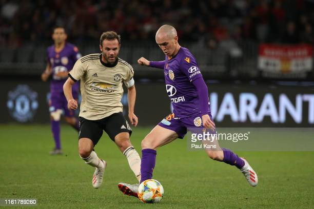 Neil Kilkenny of the Glory passes the ball during the match between the Perth Glory and Manchester United at Optus Stadium on July 13 2019 in Perth...