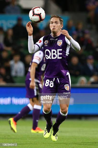 Neil Kilkenny of the Glory traps the ball during the round three ALeague match between the Perth Glory and the Brisbane Roar at nib Stadium on...