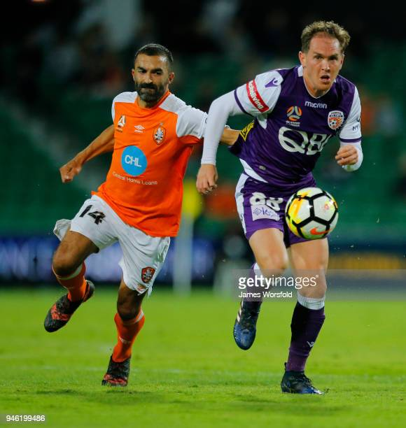 Neil Kilkenny of the Perth Glory and Fahid Ben Khalfallah of the Brisbane Roar chase down the ball during the round 27 ALeague match between the...