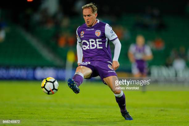 Neil Kilkenny of the Perth Glory kicks the ball into the square during the round 27 ALeague match between the Perth Glory and the Brisbane Roar at...