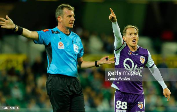 Neil Kilkenny of the Perth Glory tells one of his players off for giving away a free kick during the round 27 ALeague match between the Perth Glory...