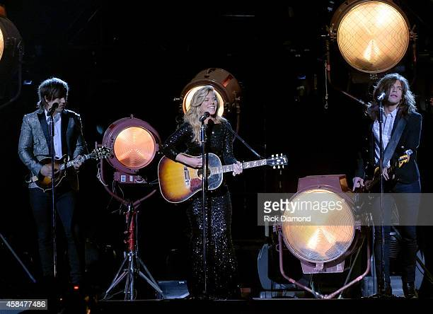Neil Kimberly and Reid Perry of The Band Perry perform during the 48th annual CMA Awards at the Bridgestone Arena on November 5 2014 in Nashville...