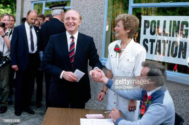 Neil Kinnock Labour Party Leader center and his wife Glenys Kinnock center right collect their ballot papers at the Pontllanfraith polling station...
