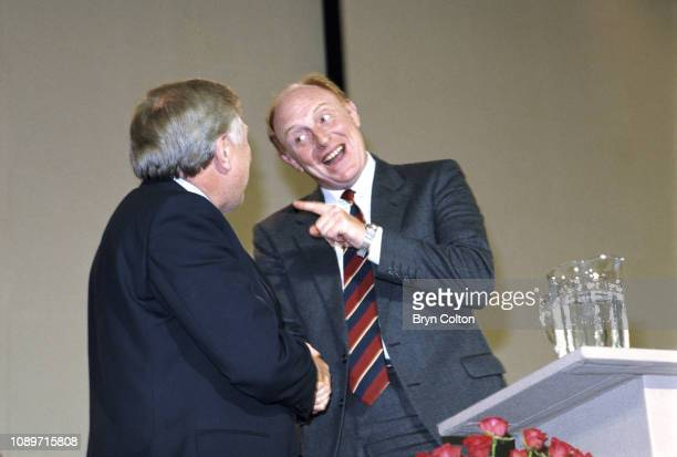 Neil Kinnock leader of the Labour Party and member of Parliament right gestures to Roy Hattersley deputy leader of the Labour Party and member of...