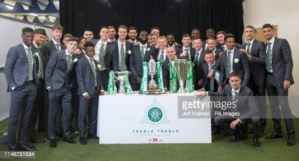 Neil Lennon and the Celtic team celebrate with the trophies after winning the treble treble during the William Hill Scottish Cup Final at Hampden...