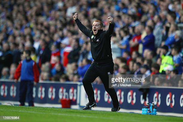 Neil Lennon coach of Celtic celebrates a goal during the Clydesdale Bank Premier League match between Rangers and Celtic at Ibrox Stadium on...