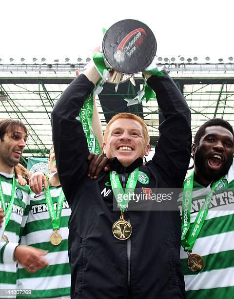 Neil Lennon coach of Celtic lifts the Clydesdale Bank Premier League trophy following the Clydesdale Bank Premier League match between Celtic and...