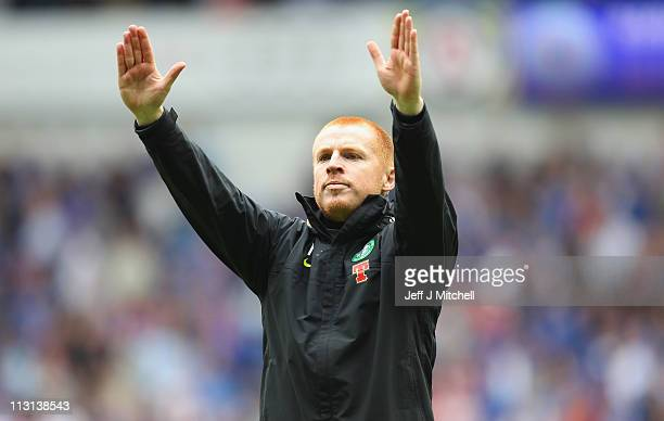 Neil Lennon coach of Celtic salutes his supporters at the end of the Clydesdale Bank Premier League match between Rangers and Celtic at Ibrox Stadium...