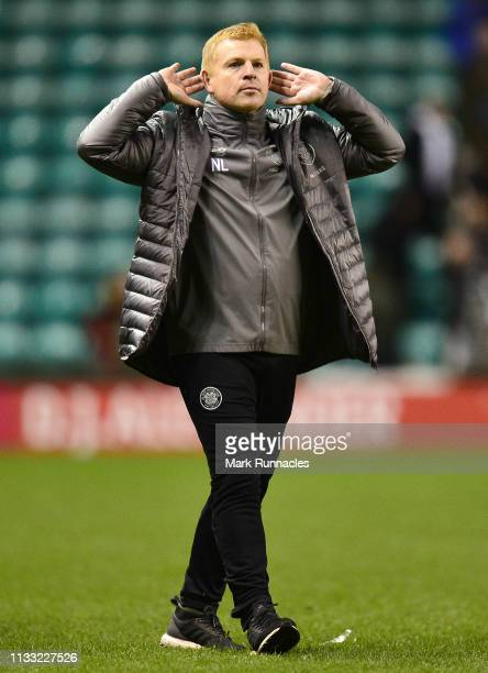 Neil Lennon Interim manager of Celtic acknowledges the fans following the Scottish Cup quarter final match between Hibernian and Celtic at Easter...