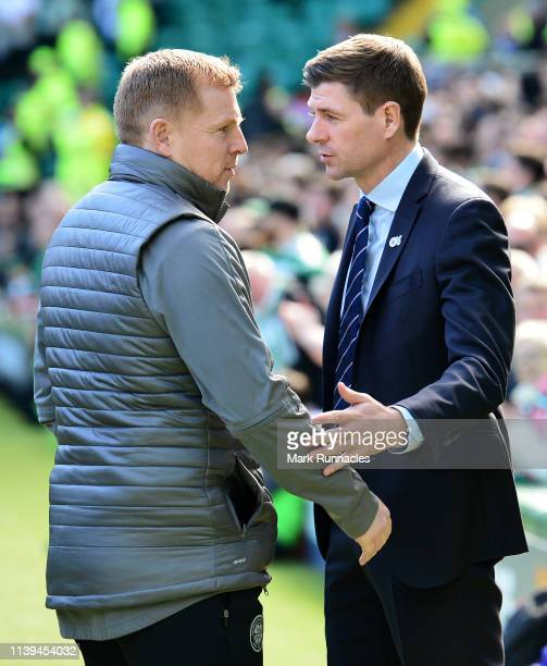 Neil Lennon Interim manager of Celtic embraces Steven Gerrard Manager of Rangers ahead of the Ladbrokes Scottish Premiership match between Celtic and...