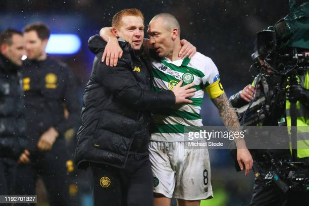 Neil Lennon Manager of Celtic and Scott Brown of Celtic celebrate following the Betfred Cup Final between Rangers FC and Celtic FC at Hampden Park on...