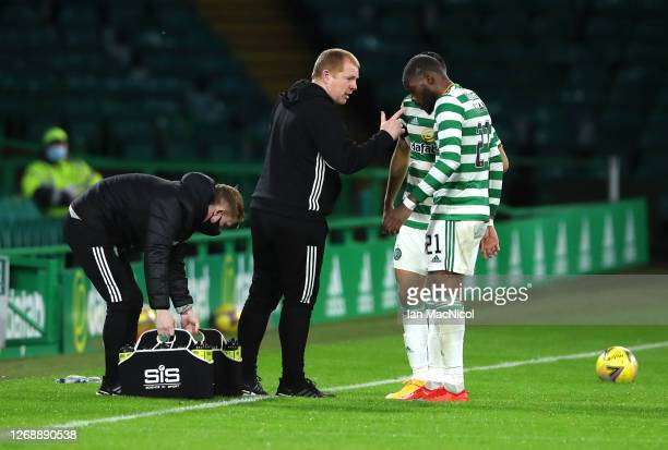 Neil Lennon Manager of Celtic gives instructions to Olivier Ntcham of Celtic during the UEFA Champions League Second Qualifying Round match between...