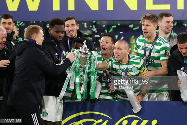 Neil Lennon, Manager of Celtic lifts the William Hill Scottish Cup with Scott Brown of Celtic after victory in a penalty shoot out in the William...