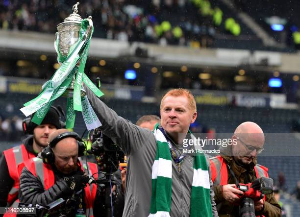 Neil Lennon manager of Celtic poses with the Scottish Cup at the final whistle during the Scottish Cup Final between Heart of Midlothian FC and...