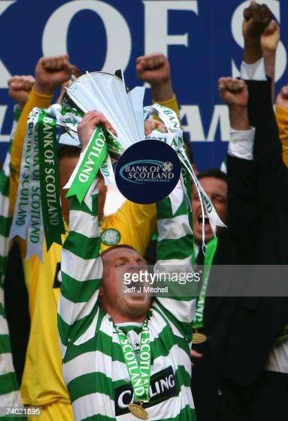 Neil Lennon of Celtic lifts the Premier Legue trophy after the Scottish Premier League match between Celtic and Hearts at Celtic Park on April 29...