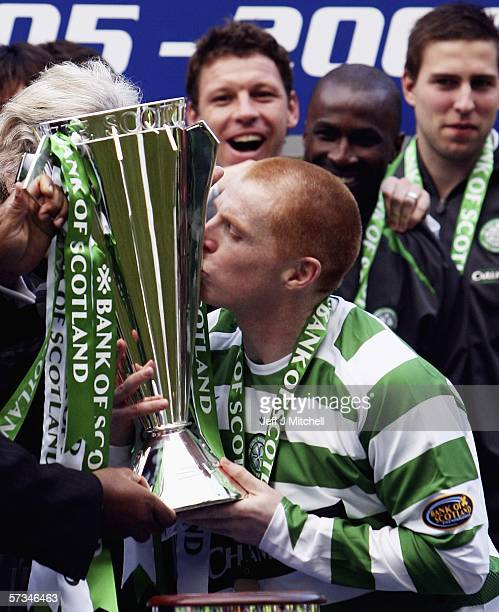 Neil Lennon of Celtic lifts the Scottish Premier division trophy after the match between Celtic and Hibernian at Celtic Park April 16Glasgow in...
