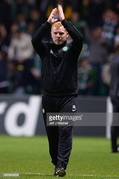 Neil Lennon the Celtic manager applauds the home fans following their team's 21 victory during the UEFA Champions League Group H match between Celtic...