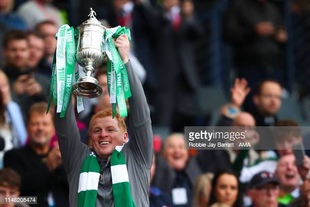 Neil Lennon the head coach / manager of Celtic celebrates with the William Hill Scottish Cup during the William Hill Scottish Cup final between Heart...