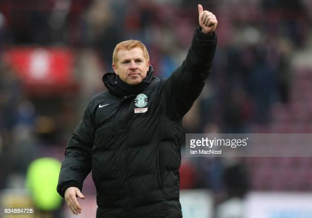 Neil Lennon the manager of Hibernian waves to the fans following the final whistle during the Scottish Cup fifth round match between Heart of...