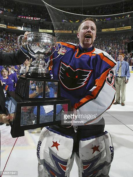 Neil Little of the Philadelphia Phantoms celebrates with the Calder Cup after the Phantoms defeated the Chicago Wolves 5-2 to sweep the series at the...