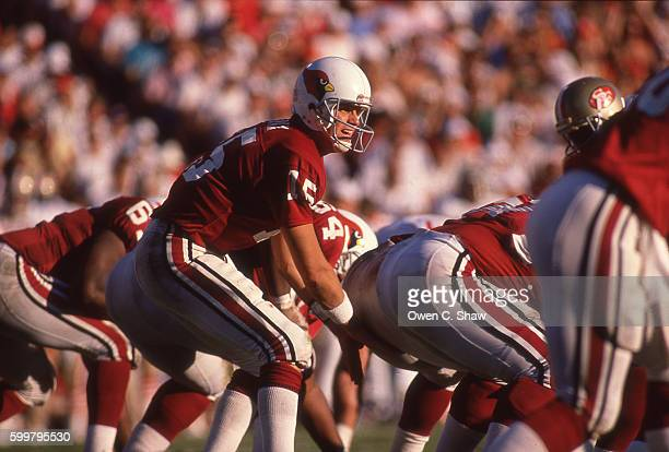 Neil Lomax of the Arizona Cardinals circa 1988 takes snap against the San Francisco 49ers at Sun Devil Stadium in Phoenix Arizona