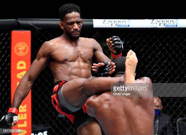 Neil Magny kicks Geoff Neal in a welterweight fight during the UFC Fight Night event at UFC APEX on May 08, 2021 in Las Vegas, Nevada.