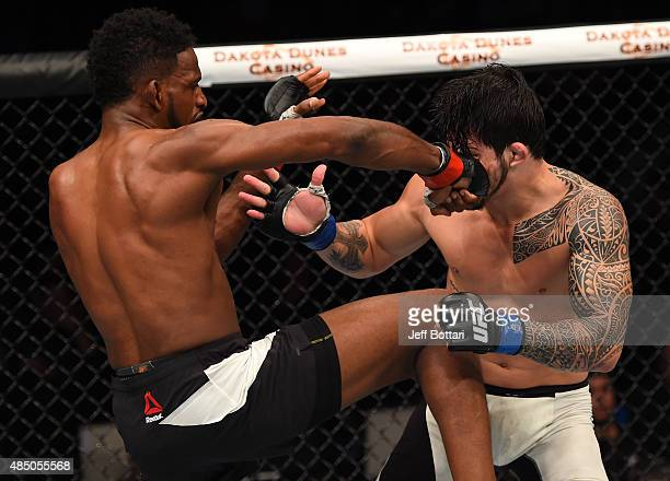 Neil Magny of the United States punches Erick Silva of Brazil in their welterweight bout during the UFC event at the SaskTel Centre on August 23 2015...