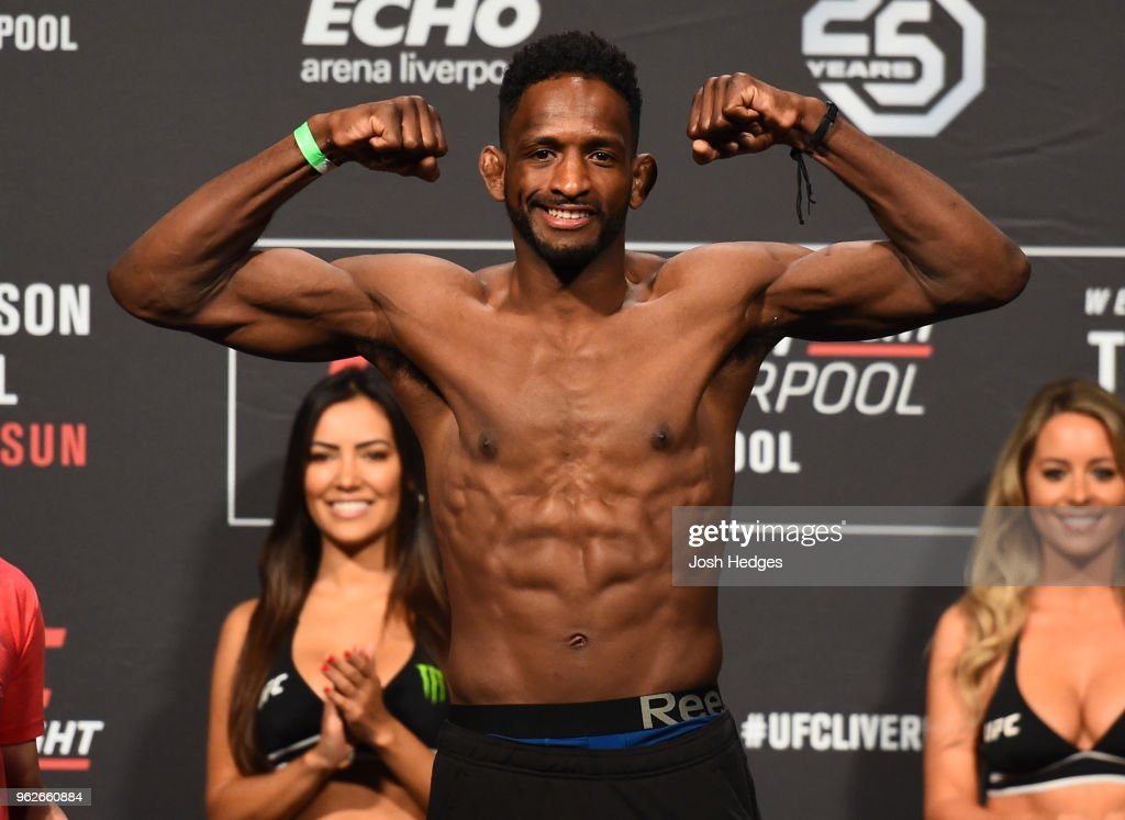 Neil Magny poses on the scale during the UFC Weigh-in at ECHO Arena on May 26, 2018 in Liverpool, England.