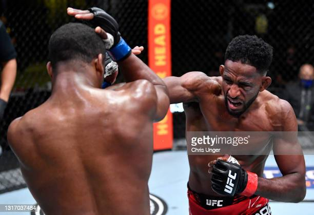 Neil Magny punches Geoff Neal in a welterweight fight during the UFC Fight Night event at UFC APEX on May 08, 2021 in Las Vegas, Nevada.