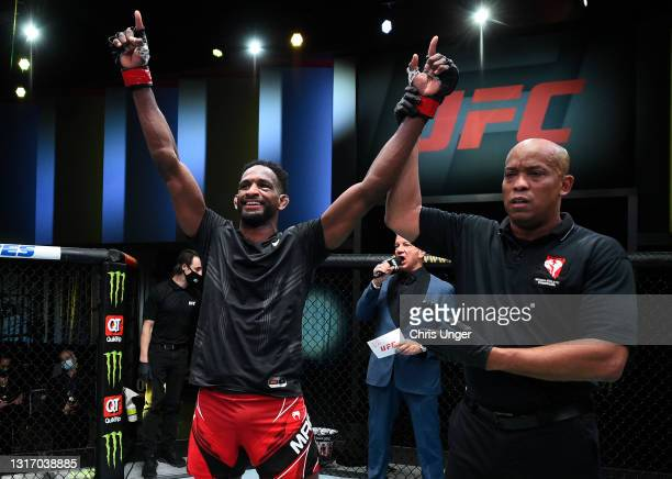 Neil Magny reacts after his victory over Geoff Neal in a welterweight fight during the UFC Fight Night event at UFC APEX on May 08, 2021 in Las...